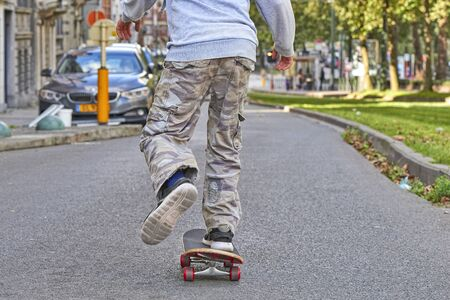 BRUSSELS, BELGIUM - SEPTEMBER 17, 2017: Young teenager boy practice skateboarding during the Car Free Streets day on Lambermont Blvd. in Brussels, Belgium