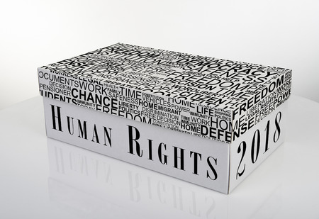 White shoe box with 2018 Human Rights words on white table with reflection, Clipping Path for the box Standard-Bild