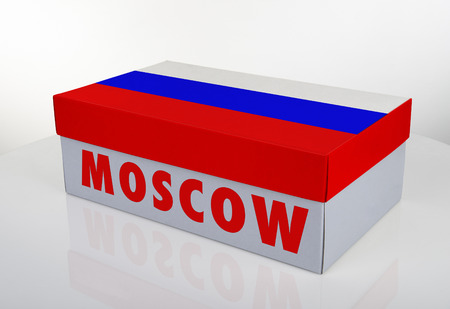 White shoe box and Russian flag on white table with reflection, Clipping Path for the box