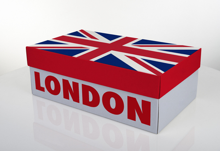 White shoe box and English flag on white table with reflection, Clipping Path for the box
