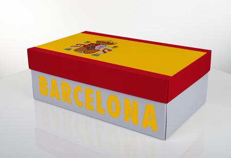 White shoe box and Spanish flag on white table with reflection, Clipping Path for the box