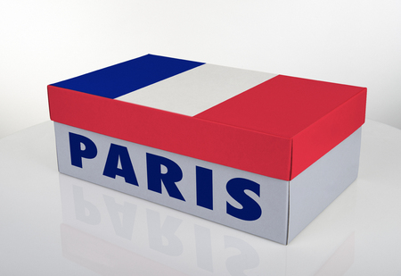 White shoe box and French flag on white table with reflection, Clipping Path for the box