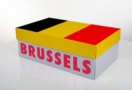 White shoe box and Belgium flag on white table with reflection, Clipping Path for the box Standard-Bild