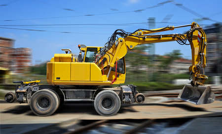 Yellow Bulldozer in movement on construction site