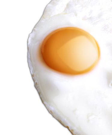 One egg baked and dressed isolated on white plate in close-up