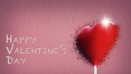 Heart-shaped lollipop shattered for the Valentines day Standard-Bild