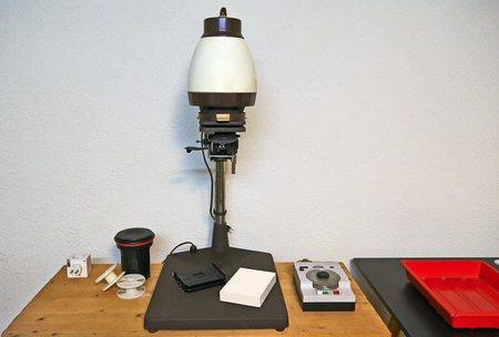 Photo enlarger and accessories in darkroom Stok Fotoğraf - 98919213