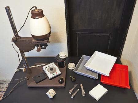 Photo enlarger and accessories in darkroom Stok Fotoğraf - 98918726