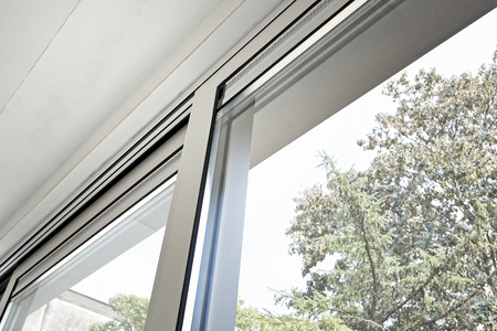 Sliding glass door and his ventilation system, before painting the wall Standard-Bild