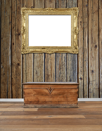Interior with old wooden chest and golden antique frame at wall