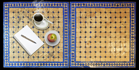Notepad on Two moroccan mosaic table, view from above