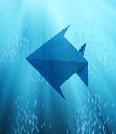 Blue fish in Origami floating in deep blue sea