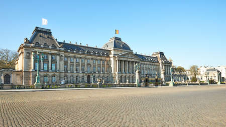 Brussels, Belgium - April 05, 2020: White flag floating on the roof from the Royal Palace during the confinement period.The Palace intends to express its solidarity with the nursing staff. Editorial