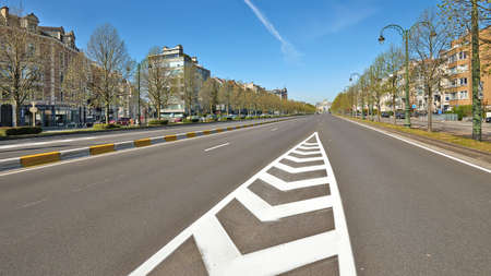 Brussels, Belgium - April 07, 2020: The Tervueren avenue from Montgomery square at Brussels without any people and car during the confinement period.