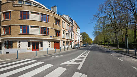 Brussels, Belgium - April 07, 2020: The Louis Bertrand avenue from the Voltaire avenue at Brussels without any people during the confinement period.