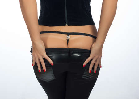 leather pants: Girl in the studio Stock Photo