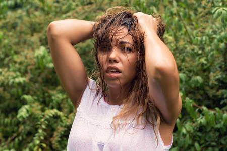 disheartened: Wet girl in the woods