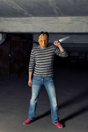 killer: killer with a knife in a dark dungeon