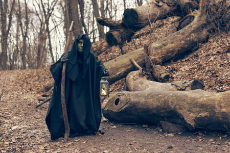 cassock: the green witch in the autumn forest Stock Photo