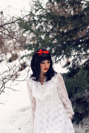 pretty girl adventures in the winter forest 写真素材