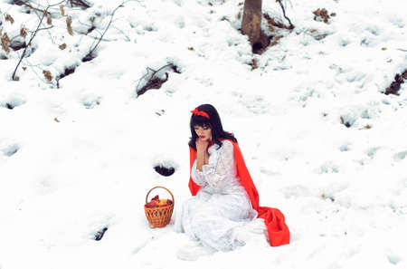 pretty girl adventures in the winter forest Stock Photo