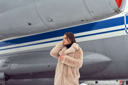 Tourist girl in winter at the airport Imagens