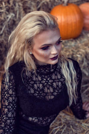 Halloween location with a young blonde 스톡 콘텐츠 - 132821331