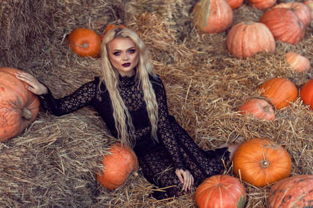 Halloween location with a young blonde 스톡 콘텐츠 - 132843028