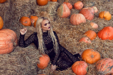Halloween location with a young blonde 스톡 콘텐츠 - 132843031