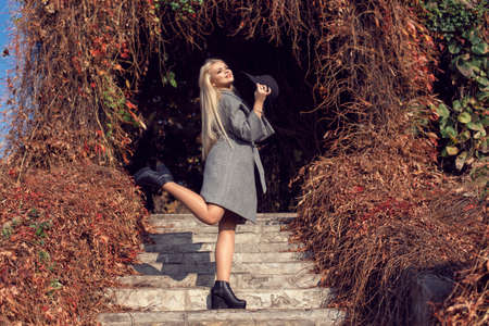 Autumn walk in the park with a cute blonde 스톡 콘텐츠 - 133463819