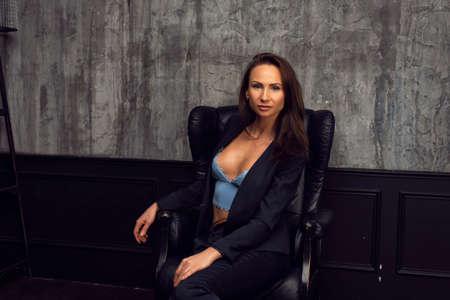 Slim girl photo session in interior studio 版權商用圖片