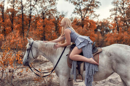 Autumn photo session in the park with a horse