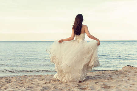 Bride in a white dress by the sea