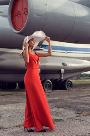 Brunette woman at the airfield