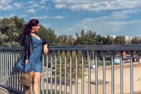 Young brunette in denim dress Фото со стока