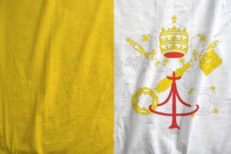 Flag of Vatican City waving.