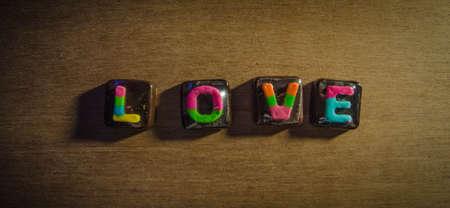 A L-O-V-E Chocolate on a wood