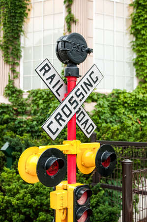 railroad crossing: yellow railroad crossing sign