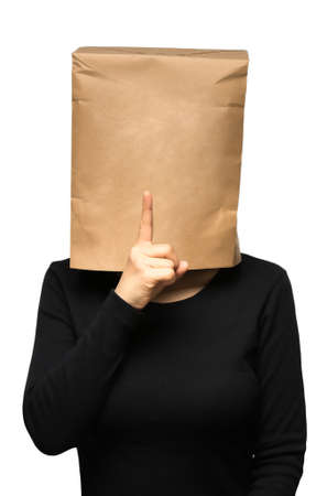with bag: young woman covering his head using a paper bag. quiet Stock Photo