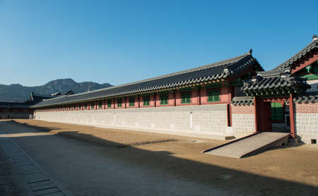 long lived: SEOUL, SOUTH KOREA - January 11, 2016: Gyeongbokgung Palace in Korea. Building built in the Joseon Dynasty. Small doors and palaces of kings who lived long wall