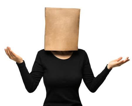 young woman covering his head using a paper bag. Foto de archivo