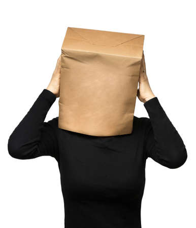 worries: young woman covering his head using a paper bag. woman worries