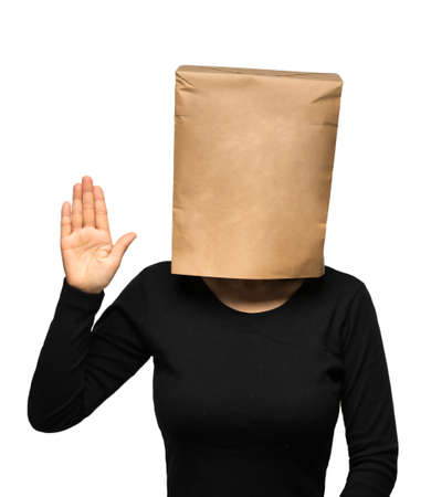 oath: young woman covering his head using a paper bag. Woman oath Stock Photo