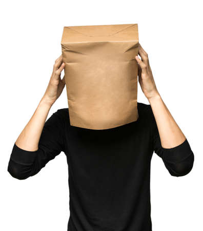 young man covering his head using a paper bag. Man thinking