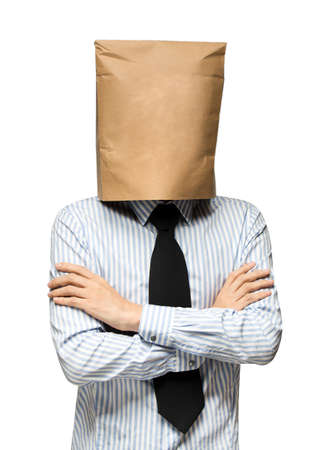 worries: young man covering his head using a paper bag. Man worries Stock Photo