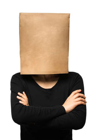 head: young woman covering his head using a paper bag. arms crossed Stock Photo