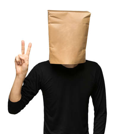 male facial: young man covering his head using a paper bag. two