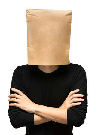 male facial: young man covering his head using a paper bag. arms crossed Stock Photo