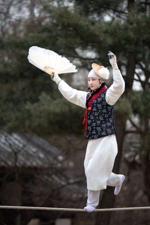 folk village: Seoul, South Korea - January 28, 2016: Acrobatics on a Tightrope walking at Korean Folk Village on January 28, 2016 in Yongin, South Korea. Korean Folk Village is a living museum type of tourist attraction.