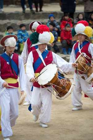occurred: Seoul, South Korea - January 28, 2016: The ending of the traditional Korea farmers dance at the Korean folk village in Yongin, Korea on January 28, 2016. The farmers dance occurred to celebrate the harvest in Korea.